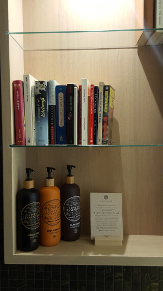 Books and organic toiletries in the bathroom. Photo: Seas & Straws