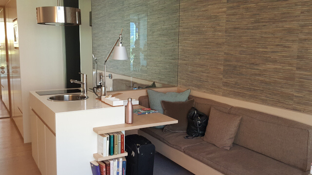The kitchenette with the desk and cozy corner - Soulmade Hotel. Photo: Seas & Straws