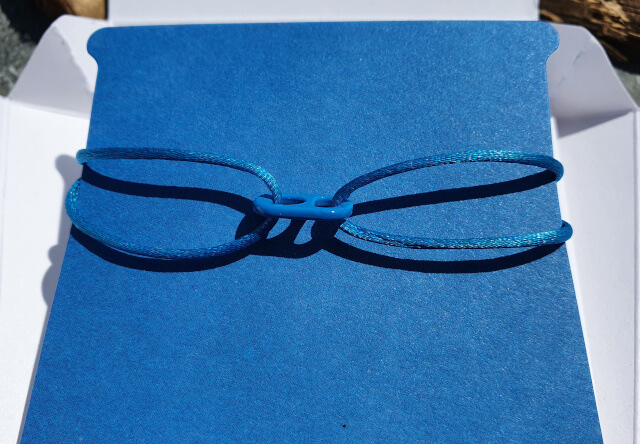 My Goal 14 Band is a vibrant blue color that looks beautiful on tanned skin. Photo: Seas & Straws
